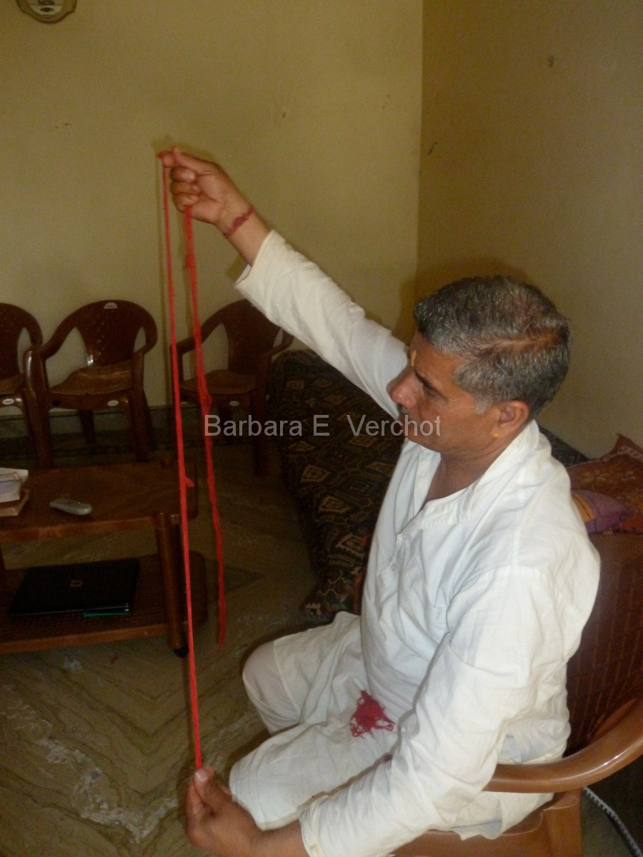 Arun's dad blessed red thread that I was integrating into the collaborative art piece.