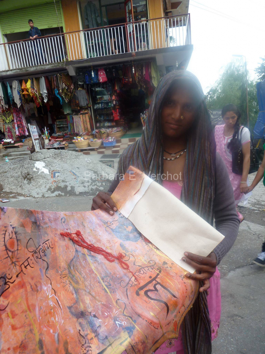 Every day, this young mother had her baby with her as she laid out her hand-carved stamps on the side of the road.